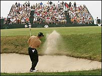 Lee Westwood plays out of a bunker on the short seventh at Shinnecock Hills