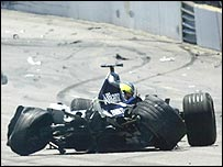 Ralf Schumacher's car comes to rest in the middle of the track following his crash