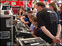 BBC staff help visitors on the mixing desk