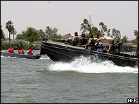 British patrol (right) with Iraqi coast guards on the Shatt al-Arab river