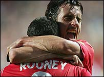 Wayne Rooney and Gary Neville celebrate