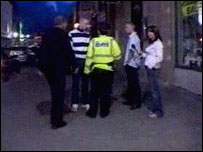 Police talking to people on a night-out on Friday