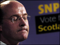 John Swinney pauses during his resignation news conference