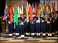 Libyan Women cadets with the 56 flags of the nations competing in the World Chess Championships