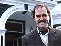 John Cleese as Basil Fawlty