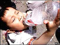 Child drinking water from water bottle