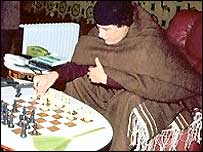 Colonel Muammar Gaddafi playing chess