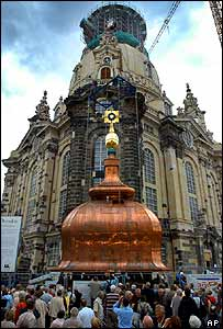 Gold orb and cross in front of Dresden's Frauenkirche