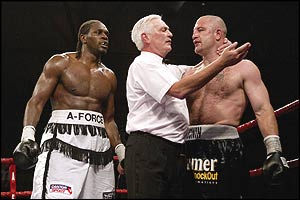 The referee stops the fight between Audley Harrison and Tomasz Bonin
