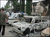 A burnt car in front of a police station in the main Ingush town of Nazran