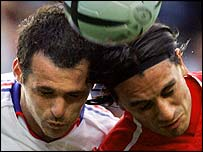 Willy Sagnol tussles with Switzerland's Hakan Yakin