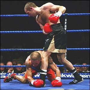 Scott Harrison knocks William Abelyan to the floor