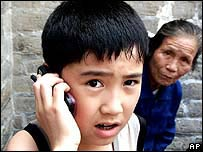 Chinese boy using mobile phone