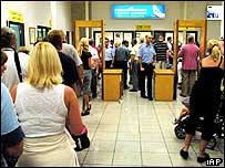 People waiting to go through metal detector at airport