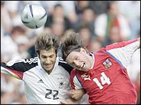 Stepan Vachousek (right) makes life uncomfortable for Torsten Frings