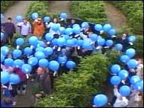 Local schoolchildren released 300 dove-shaped balloons