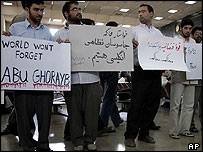 Iranian protestors hold placards