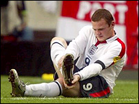 England striker Wayne Rooney tends to his injury