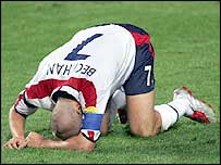 A distraught David Beckham of England