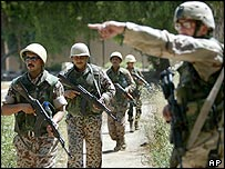 US soldier directs Iraqi troops in Baghdad