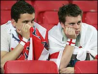 Two dejected England fans after the defeat to Portugal