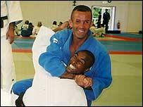 Simon Jackson (top) gets to grips with Colin Jackson