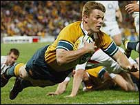 Clyde Rathbone scores the first of his three tries for Australia against England