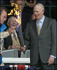 Sir Roger Bannister lights the Olympic torch on Centre Court