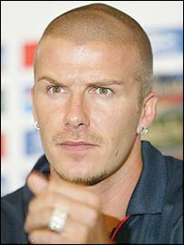 David Beckham displays an unusual scowl
