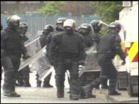 Road was cordoned off by police dressed in riot gear