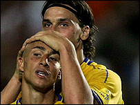 Henrik Larsson of Sweden is consoled by Zlatan Ibrahimovic