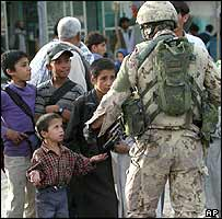 Nato soldier and children in Kabul