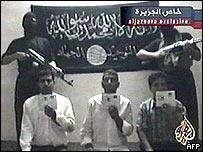 A still from al-Jazeera of gunmen and their apparent captives