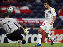 Czech Republic striker Milan Baros lifts the ball over Thomas Sorensen in Denmark's goal