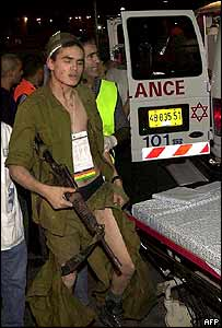 An Israeli soldier is evacuated after the explosion at the army outpost