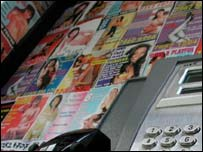 Prostitute's cards in phone box, BBC