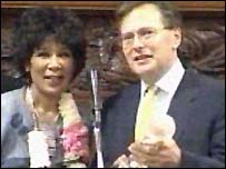 Moira Stuart receives her award from Lord Goldsmith