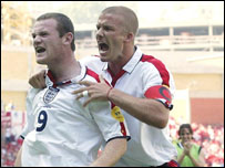 Wayne Rooney celebrates scoring against Switzerland with David Beckham