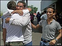 A Cuban, resident in the US hugs one of his sons upon his arrival at Havana's airport, June 2004.