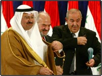 From left, Iraqi President Ghazi Al-Yawer, Vice President of Ibrahim Al-Jaafari, and Prime Minister Iyad Allawi