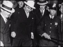 Al Capone leaves court in the custody of US Marshals, Chicago, 1931