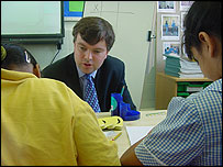 Tim Collins, shadow education secretary with pupils