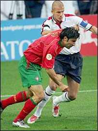 Portugal captain Luis Figo tussles with England rival and Real Madrid team-mate David Beckham during the Euro 2004 quarter-final between their two sides