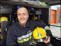 Photo of Gary Webb aboard a fire engine