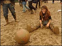 Glastonbury fan in the mud