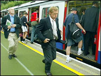 Commuters at Southfields Tube station