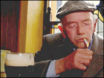 An Irish smoker lights his last cigarette before the ban