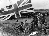 British troops raising a flag during the Falklands War