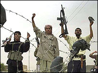 Iraqi gunmen show off their weapons