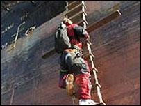 A protester climbs the ship